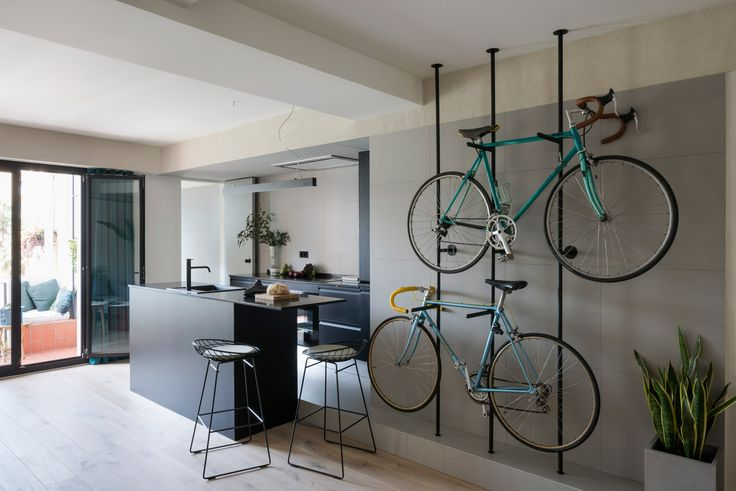 Colombo and Serboli Architecture has revamped a Barcelona apartment, opening up the partitions to create a living space with a wall-mounted bicycle rack