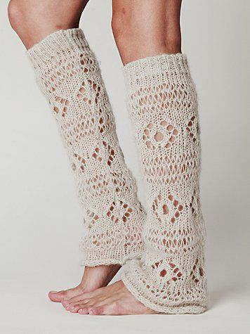 Lace legwarmers under boots over dark colored tights