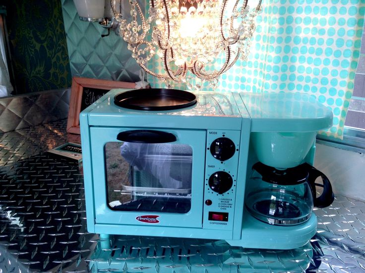My turquoise coffee maker and oven toaster , in my vintage camper.. Check them out on Amazon! It works wonderful !.. Canned ham,vintage camper, Terri Brush turquoise, agua, chandelier, robins egg blue, www.terribrushdesigns.com