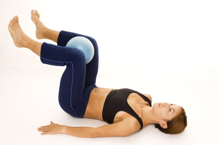 Working out with a fitness ball  http://www.sexylookingabs.com