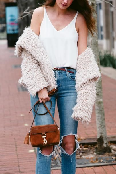 The Miller Affect wearing a cream shag coat, distressed Levi jeans, and a Rebecca Minkoff suede camera bag.