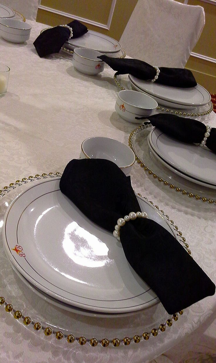 gold beaded charger plates and pearl napkin rings; by Davis Floral Creations