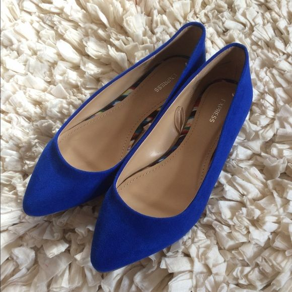 Brand knew royal blue flats Never been worn and brand new!!! Perfect condition!!! No scuffs or any marks!! The picture makes the bottoms look worn but they haven't!! Perfect shoe to make an outfit pop!! Express Shoes Flats & Loafers