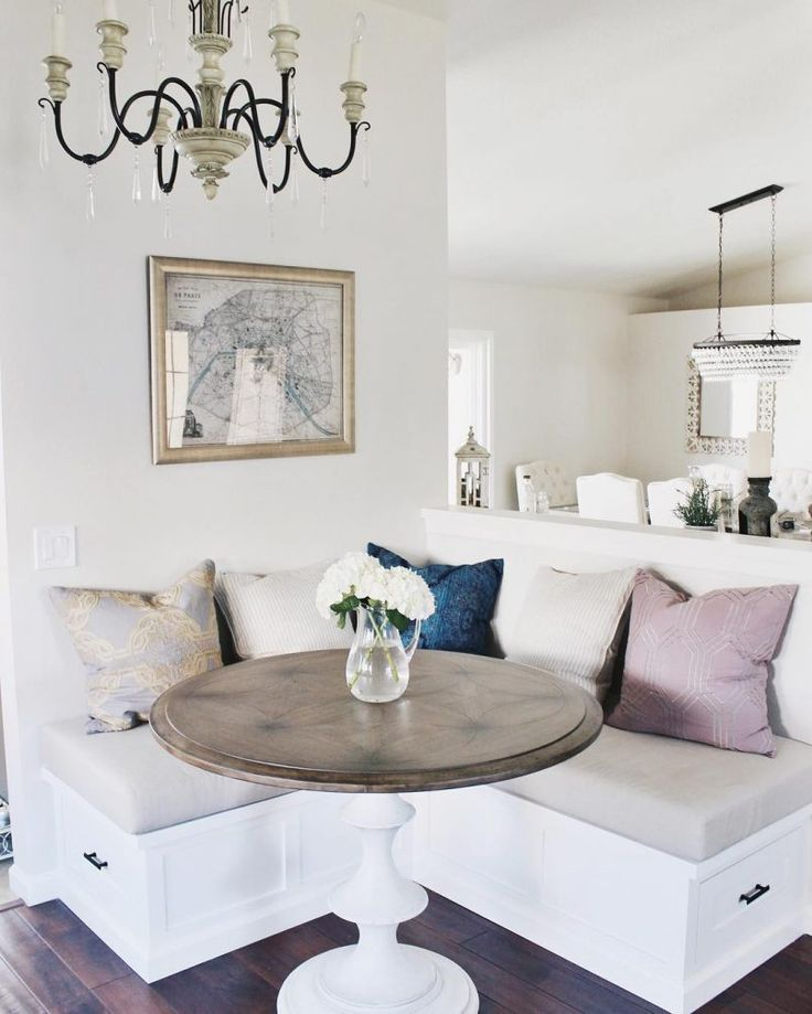 This very small breakfast nook has a nice contemporary design. The chandelier, rounded marble table top and multicolour cushions make this one of my personal favorites. Pin this to your home décor board!