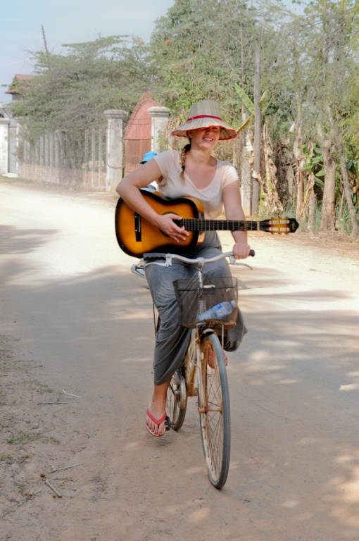 Biking with her guitar in Cambodia. #outreach #dts
