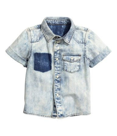 Check this out! Short-sleeved shirt in soft, washed denim. Pearlescent snap fasteners, one chest pocket with flap and snap fastener, and darker area where one chest pocket has been torn off. - Visit hm.com to see more.