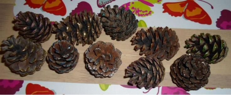 Pine cones painted with nail polish.