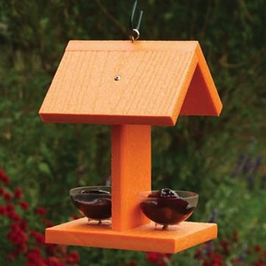 The Oriole Bird Feeder has two jelly dishes for hungry orioles. The orange poly-lumber is made from recycled plastics.