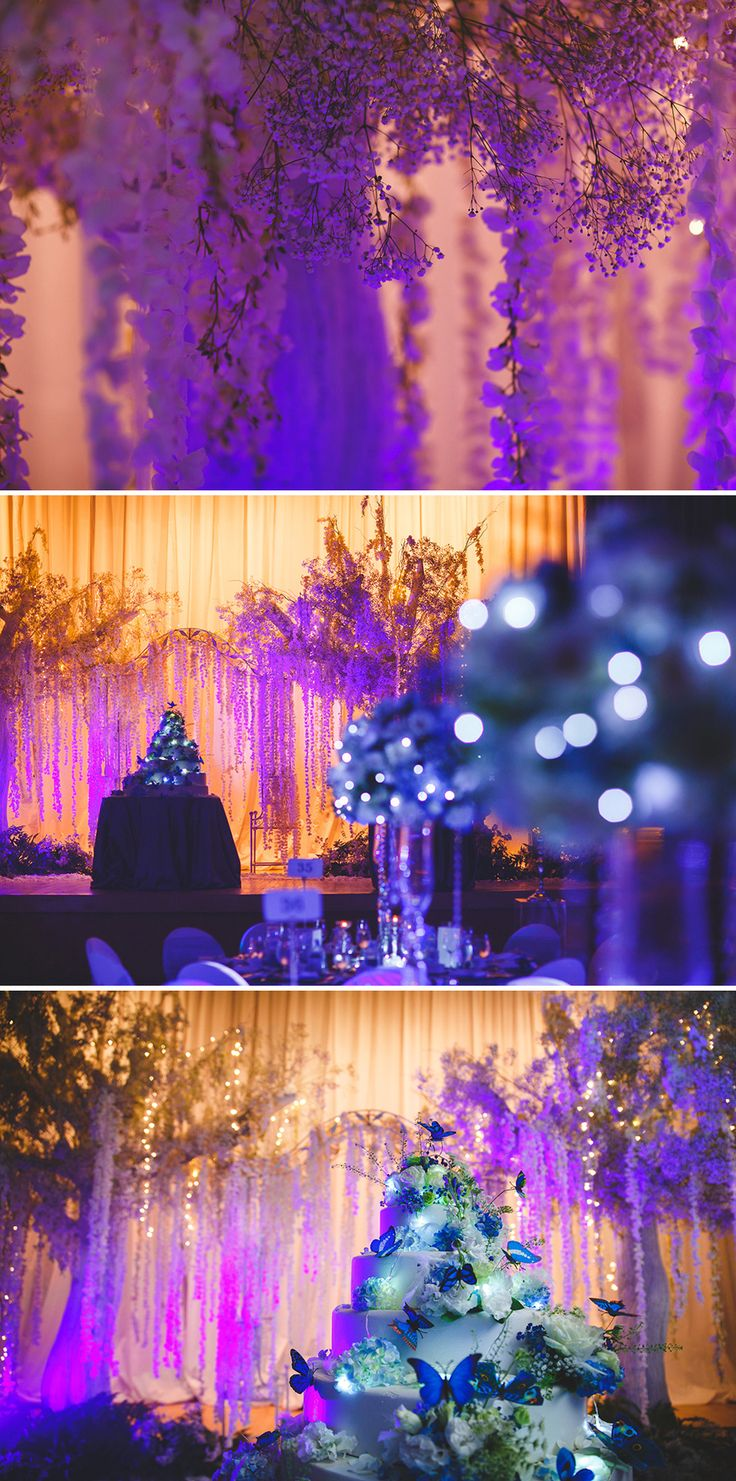 Draping floral backdrop, a gorgeous multi-tiered lighted wedding cake and a soft romantic purple glow // Vincent and Veron decided on a winter wedding theme, and worked with The Wedding Entourage and Boenga to decorate The Ritz-Carlton Millenia Singapore's ballroom so that it matched Veron's wedding gown, which featured hand painted glow-in-the-dark flowers from Tiara Bridal. The couple's first march-in was made magical with the bride in her glowing gown, groom with his LED pocket square…