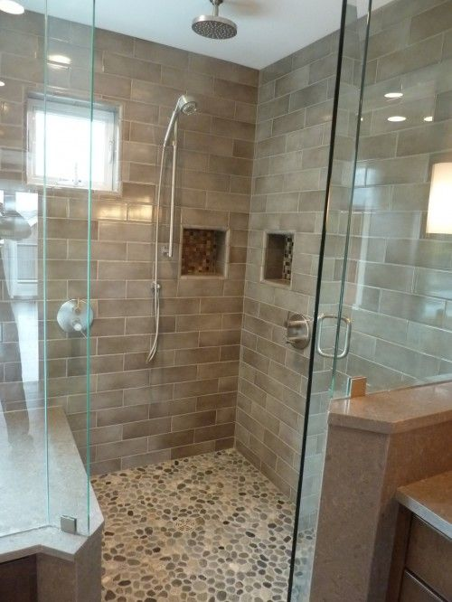 My favorite tiled shower with frameless glass doors. There is a bench and windows