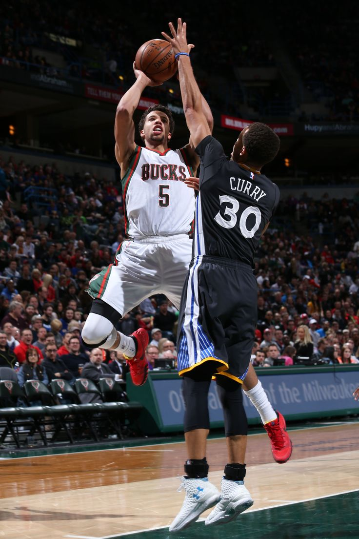 Michael Carter-Williams #5 of the Milwaukee Bucks goes up for a shot against the Golden State Warriors on March 28, 2015 at BMO Harris Bradley Center in Milwaukee, Wisconsin. (Photo by Gary Dineen/NBAE via Getty Images)