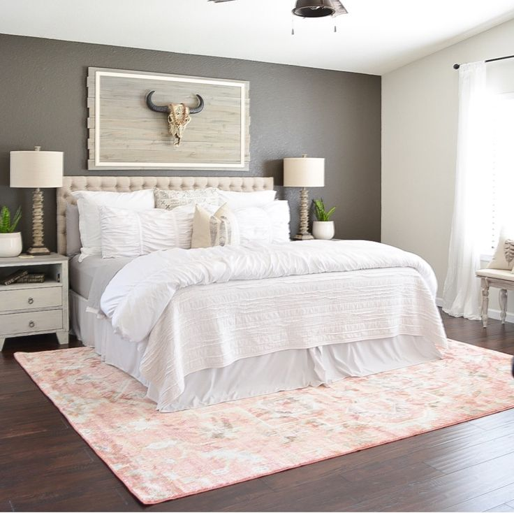 Boho Master Bedroom With Dark Gray Accent Wall And Blush