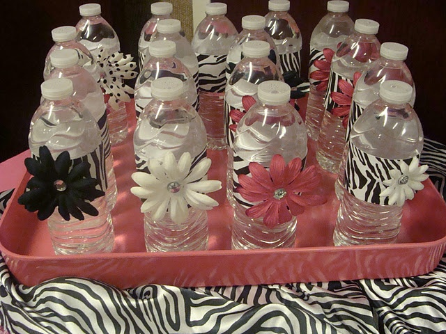 fancy water bottles - using duct tape and flowers to match your theme/colors