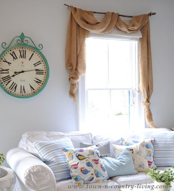For less than $10 per window, you can make pretty landscape burlap swag curtains without having to sew a thing! See how!