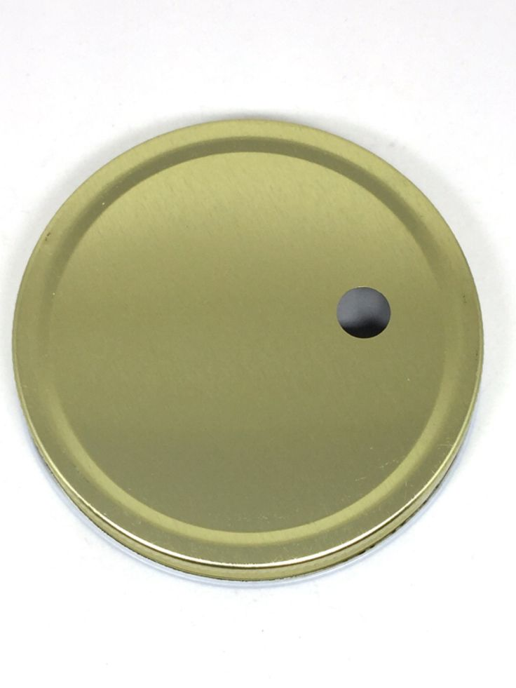 Gold wide mouth mason jar lid. Larger straw hole for stainless steel , glass and paper straws. Offset hole easier to drink from.