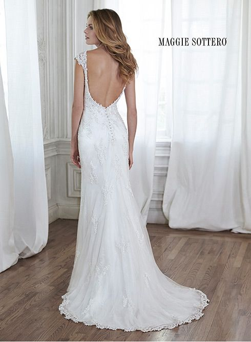 Slim A-line lace wedding dress with illusion neckline, lace cap-sleeves and dramatic plunging back. Leticia by Maggie Sottero.