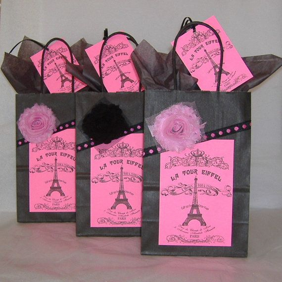 Three Black Gift Bags with Paris Eiffel Tower Souvenir Labels in Hot Pink, Fabric Flowers, Matching Gift Tags, and Black Tissue Paper