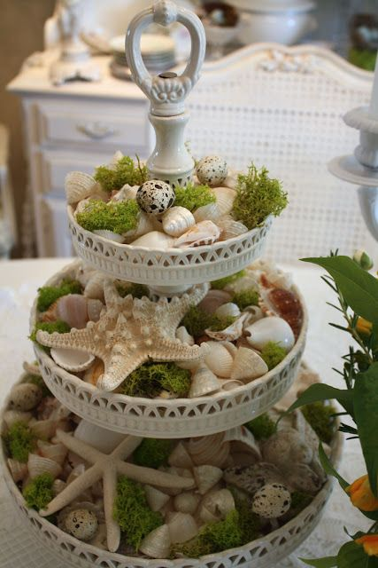 Metal tiered snack server; painted white.  Shells are even prettier accented with moss.