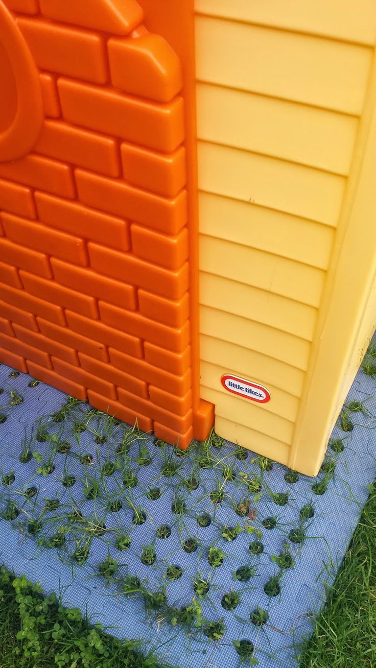 Create a base/floor for your playhouse by simply buying outdoor floor tiles. This allows the grass to grow under. http://www.mummytothemax.co.uk/2014/06/little-tikes-playhouse-review.html