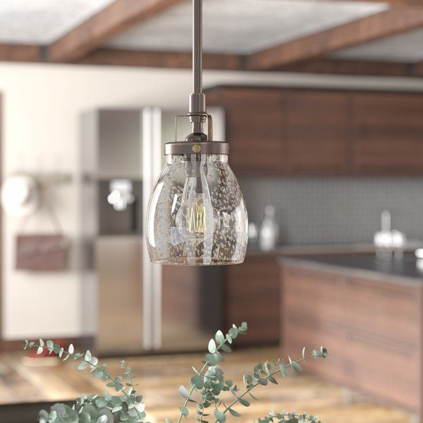 This 1 light mini pendant in heirloom bronze is the perfect way to achieve your desired fashion or functional needs in your home. Influenced by the vintage industrial designs of early 20th Century America, the transitional lighting collection has seeded glass shades that highlight the classic Edison bulbs. The rich heirloom bronze finish adds another layer of retro design to the warm look. Incandescent medium-base lamping.