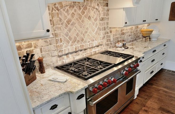 """Thin brick tiles used as backsplash. We would recommend our Snohomish color mix or 100% natural colored bricks with an installation technique called """"floating"""" the grout. This tile was installed using a running bond and herringbone pattern."""