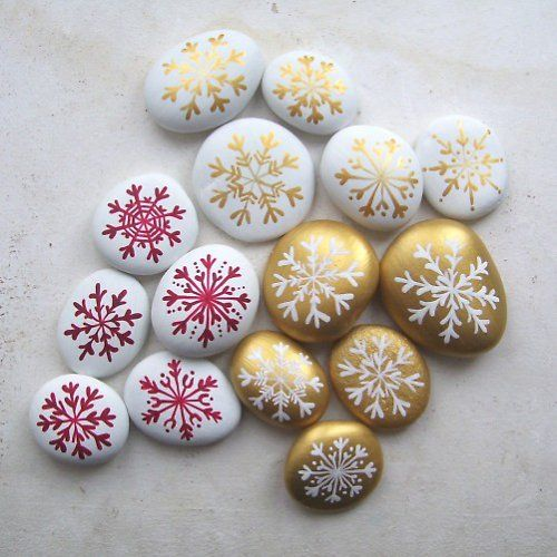 Snowflake painted stones...cute in a basket or to replace decorative stones in…