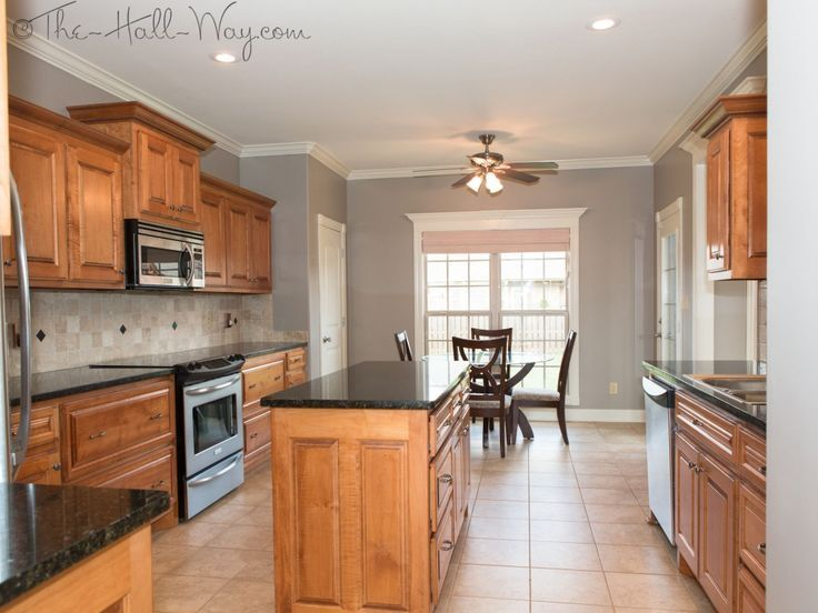 Kitchen w maple cabinets with cherry stain and mocha glaze uba tuba granite tumbled marble Kitchen designs with grey walls