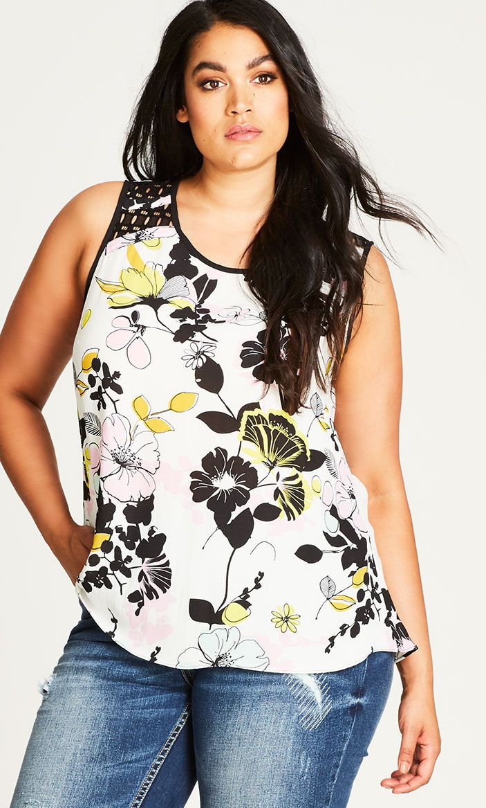 Spring has sprung with the beautifully printed Art Darling Top.  Key Features Include: - Rounded scoop neckline - Sleeveless cut - Lace insert yoke - Relaxed hemline - Back keyhole opening