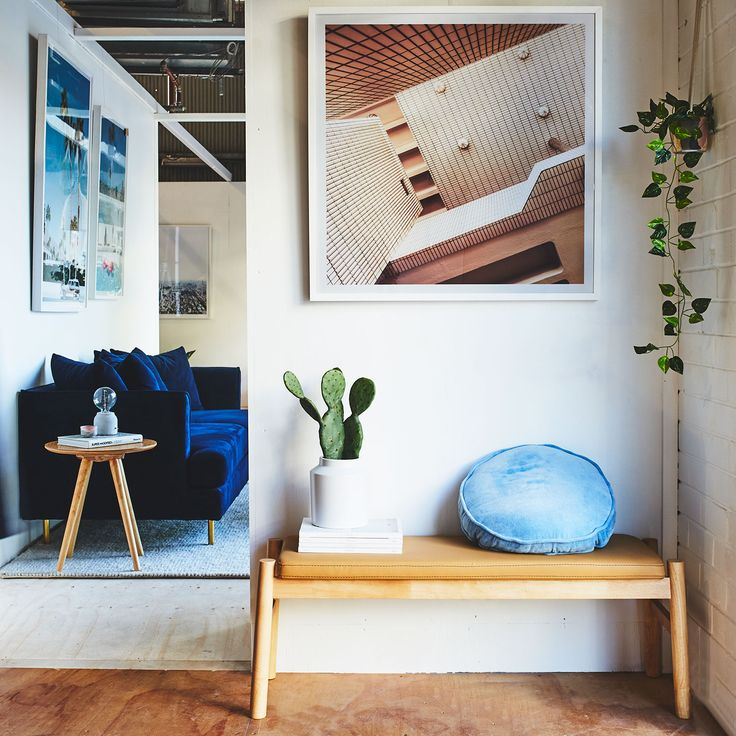 Keep It Simple - Style your entrance wall with some natural timber accent, an artwork and indoor plants.