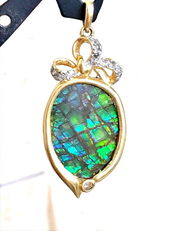 Excited to share the latest addition to my #etsy shop: Supreme 14k Gold Ammolite Diamond Gemstone Pendant Imperial http://etsy.me/2AQj12d #jewelry #necklace #unisexadults #gold #ammolite #pendant #diamond #gemstone #canadawww.etsy.com/shop/jurrasicrockshop