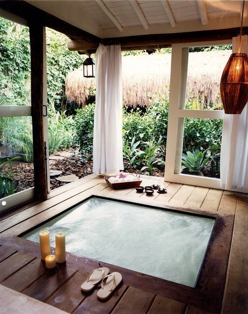 built in hot tub with awesome sun room surrounding it #furniturehunters
