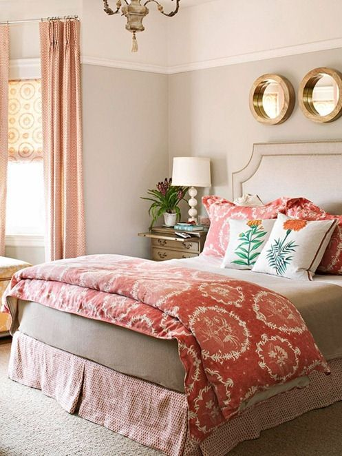 layered patterns in bedroom - coral on coral. Change scale of patterns, depending on what you want focal piece to be (in this case the large-scale medallion duvet and shams)