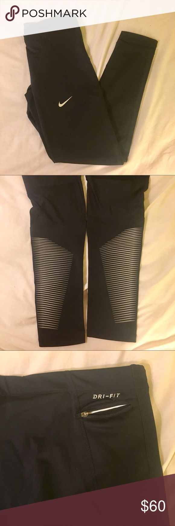 NIKE black leggings Black Nike leggings in amazing condition!! Adjustable waist, pocket with zipper on the back, gray detailing on the bottom leg area, mesh-like fabric behind the knee. ASK QUESTIONS😊 Nike Pants Leggings