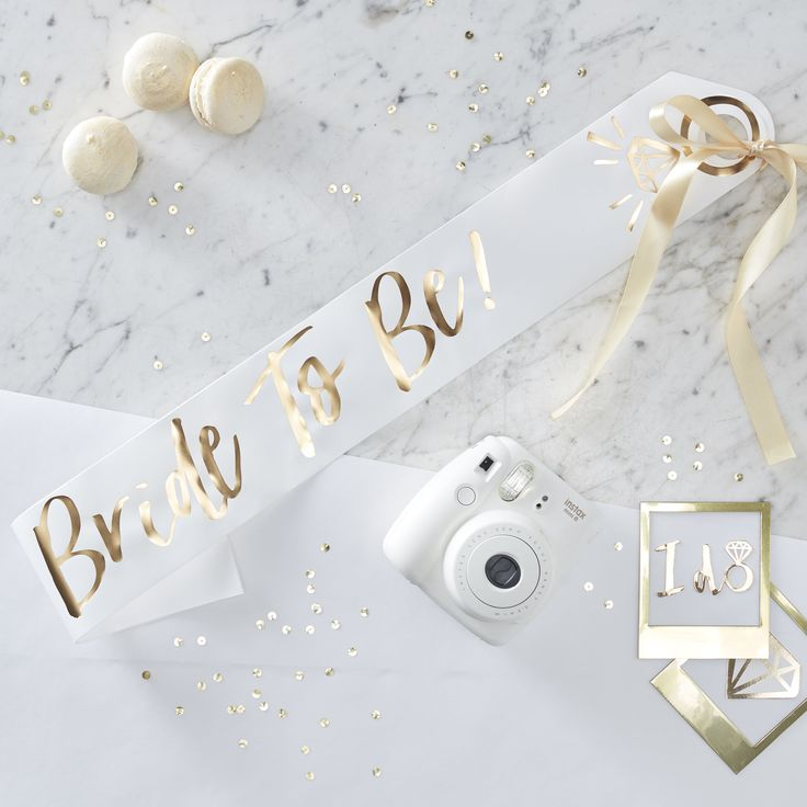 The Bride to be will feel extra special with our sophisticated 'Bride To Be' hen party sash. Make the bride centre of attention and instantly recognisable as you celebrate away. The bridal themed gold foiling on a white background will look stunning with the brides outfit.  The paper sash is sophisticated and trendy - with a gold ribbon that threads through to tie up. The bride will never want to take it off! One size fits all.