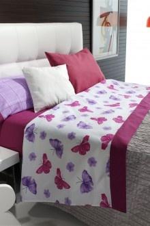 """Juego de sabanas de """"Javier Larrainzar Casa"""".    Con un bonito estampado de mariposas y flores en colores violetas y rosas.    Esta disponible para camas de 90, 105, 135, 150, 180.    COMPOSICIÓN  50% algodón 50% poliéster"""
