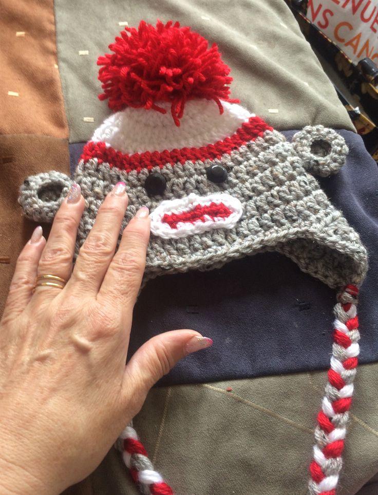 Sock monkey hat for a newborn.