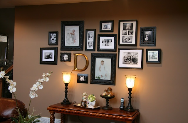 Photo Wall Inspiration - I love the monogram idea and the placement above the table with the lamps adding to the feature -