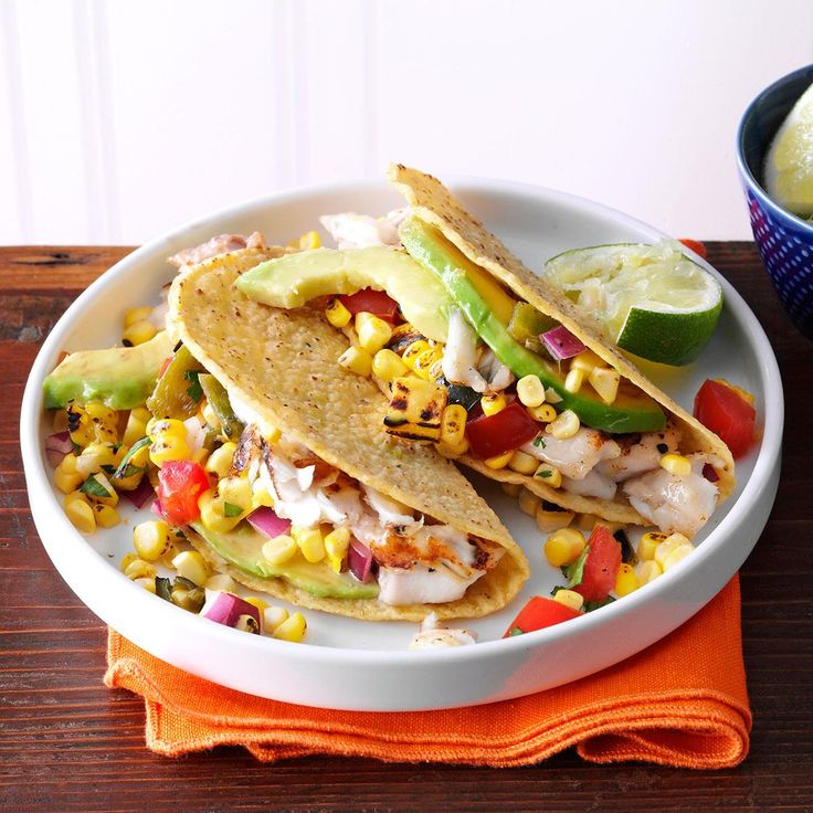 Summer Garden Fish Tacos Recipe -I like to serve fish tacos with quinoa and black beans for a complete and satisfying meal. If you've got them, add colorful summer toppings like bright peppers, green onions or purple carrots. —Camille Parker, Chicago, Illinois
