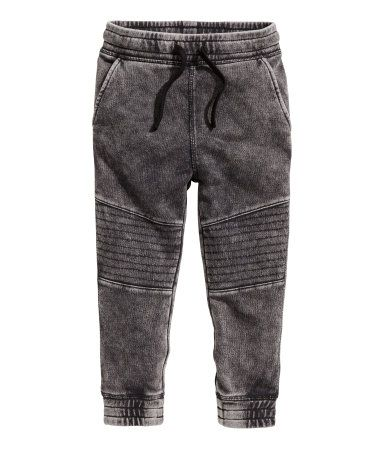 Jogger-style pants in sweatshirt fabric with a washed denim look. Elasticized drawstring waistband, side pockets, one back pocket, quilted panels at knees, and elasticized hems.