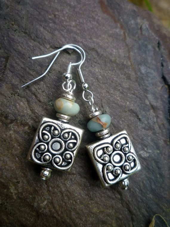 Items similar to Tibetan silver and Ocean Impression stone rondell on Etsy