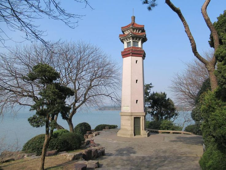 The best view of Lake Taihu is from this lighthouse on a peninsula in the Turtle Head Garden at Wuxi, China.
