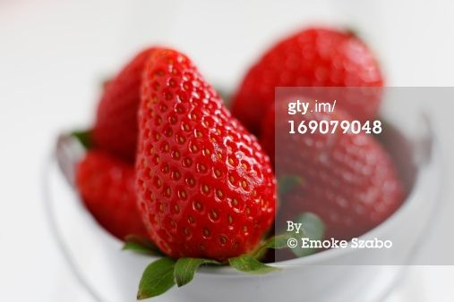 strawberries in a white bowl by Emoke Szabo