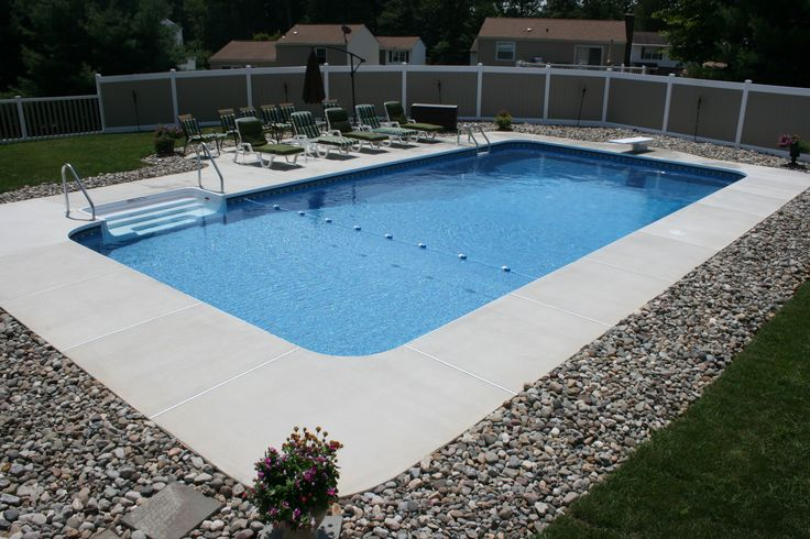 rectangle style pool with brushed concrete decking… | pool