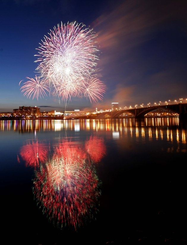 Fireworks explode above the Yenisei River as part of the Victory Day celebration in the Russia's Siberian city of Krasnoyarsk, May 9,