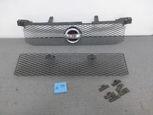 a 2002 2003 nissan sentra se r upper and lower metal grille assemblies 740