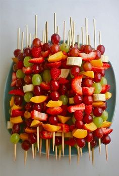 Fruit Salad on a skewer, has grapes, strawberries, peaches, and other fresh fruits