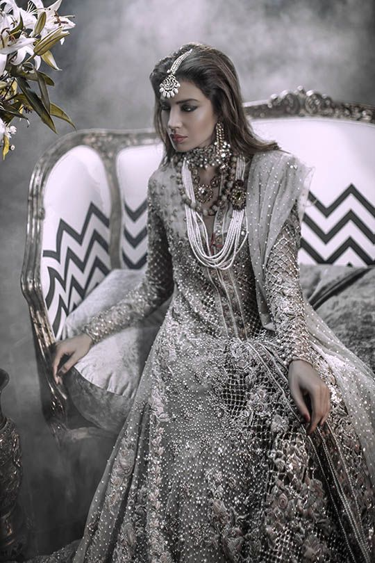 I love the intricacy of the mesh work on this Pakistani Bridal outfit by Elan. Indian bridal