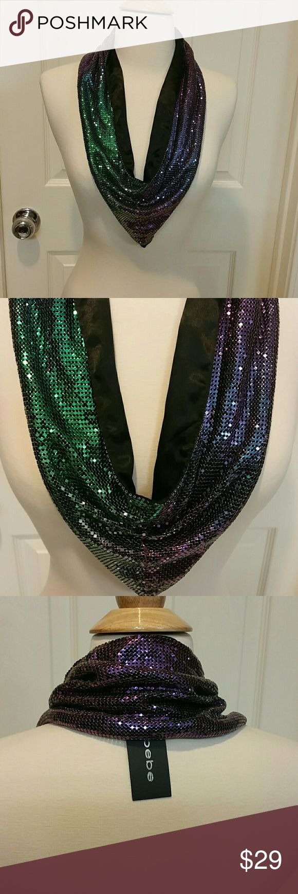 Bebe Metallic Scarf Dress up a plain outfit with this metallic scarf with glittering emerald and purple color. 100% aluminum. Price firm. bebe Accessories Scarves & Wraps