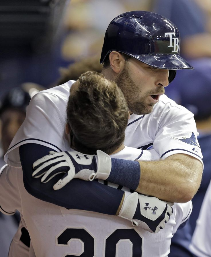 Tampa Bay Rays' Curt Casali, right, hugs Steven Souza Jr. in the dugout after Casali hit a two-run home run off Detroit Tigers starting pitcher David Price on Tuesday. Casali is the 1st rookie catcher in Major League baseball to hit 2 HRs twice in back-to-back games.  Price & Casali, also, went to Vanderbilt to college. THE ASSOCIATED PRESS
