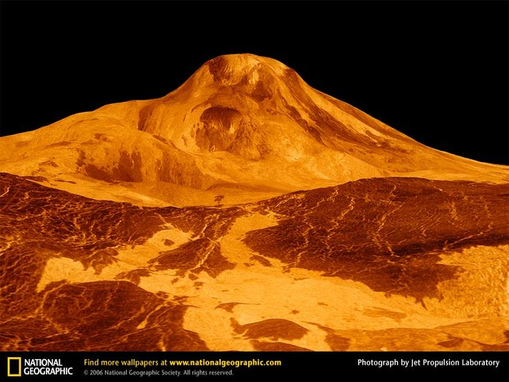 "Venus's volcano, named Maat Mons, looms above the volatile surface of the Earth's ""unruly"" twin. This image was captured by the Magellan spacecraft which also mapped 84 percent of the planet's surface in just one day—one Venus day that is, equal to 243 days on Earth. The orange tint approximates the color the human eye would see as a result of sunlight filtering through Venus's cloud cover. -- National Geographic"